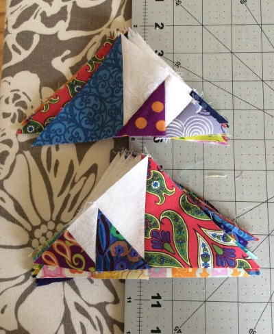 Triangles sewed to triangles and sewed to more triangles