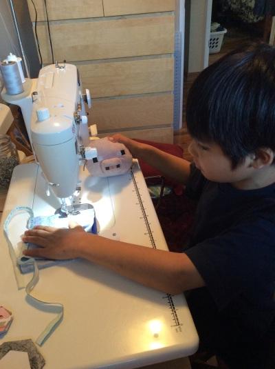 Jeffrey cape being sewn