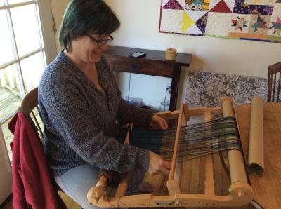 Kathie Sue weaving a scarf
