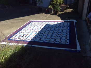 Pin basting A's quilt
